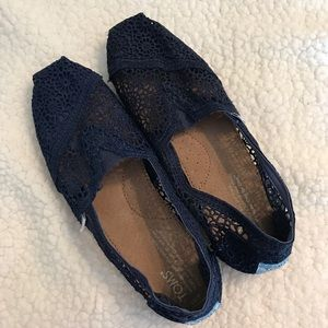 Navy lace Tom's shoes